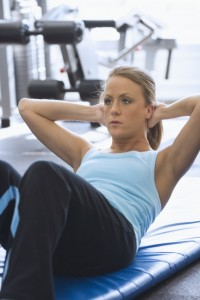 Woman Doing Sit-ups --- Image by © Royalty-Free/Corbis