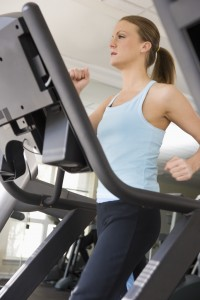 Woman Walking on Treadmill --- Image by © Royalty-Free/Corbis